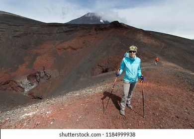 LONQUIMAY/CHILE - FEBRUARY 16 2017: a man and a woman on the top of Navidad crater, in Lonquimay volcano, Chile