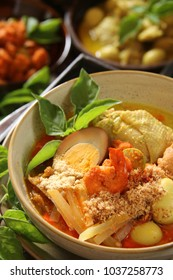 Lontong Cap Go Meh. Peranakan dish of rice cake  soup with chicken curry, spicy chayote squash curry, spicy shrimp stew, soy-braised egg, ground roasted soybean, ground roasted shrimps.