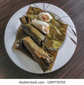 Lontong, rice filled with potatoes and carrots wrapped in banana leaves. It tastes delicious. Indonesia snack. Lontong is a Southeast Asian dish made of compressed rice cake in the form of a cylinder