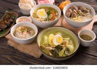 lontong sayur with bakso soto and bubur ayam on a table