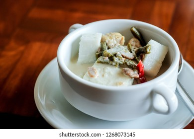 Lontong Sayur or Ketupat Sayur, an Indonesian Traditional Food Made of Ketupat (Savory Rice Cake), Shredded Chicken, Vegetable, and Coconut Milk Gravy