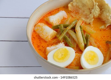 Lontong sayur lodeh is an aromatic vegetable coconut curry with compressed rice cake (Lontong), complemented with spicy broth, yardlong bean, chayote, boiled egg and emping