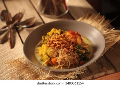 Lontong Sayur Medan. Rice cake soup with vegetable curry, egg with chili paste, fried rice noodle, and crispy tempeh; a opular vegetarian dish in Medan, North Sumatra.