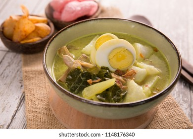 lontong sayur. rice cake with soup and vegetable. indonesian traditional culinary