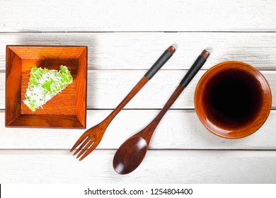 Lontong-Traditional Malaysian and   Indonesian food on wooden table with spoon.