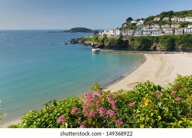 Looe beach Cornwall England with blue sea on a sunny summer day