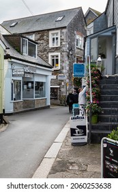 Looe, Cornwall, England UK - 10.06.2021: Buller Street, a narrow street in Looe, Cornwall. A working fishing harbour popular with visitors.