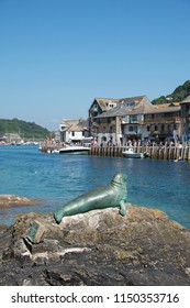 Looe, Cornwall UK - August 05 2018: Nelson the seal monument, he died in 2003, this bronze sculpture was commissioned and created by Cornish sculptor Suzie Marsh.