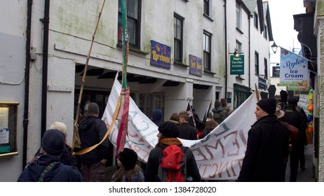 Looe, Cornwall, UK, February 16, 2019. Mixed group of Extinction Rebellion protesters, marching through the Cornish town of Looe, to highlight the environmental damage / climate change