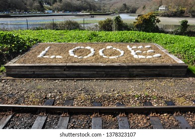 LOOE, CORNWALL/UK - April 2, 2019. Stone name beside Looe railway station, Cornwall, England