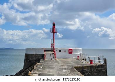 LOOE, CORNWALL/UK - April 2, 2019. Banjo Pier and cumulus clouds, Looe, Cornwall, England