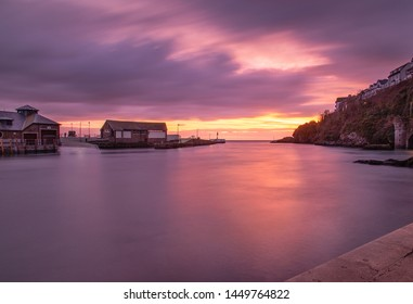 Looe Harbour at sunrise on the cornish coast