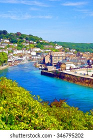 Looe town and river Cornwall England UK with blue sea and sky bright colours illustration like cartoon effect