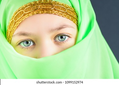 The look of a beautiful girl in a closed green hijab for oriental dance Nubia.
