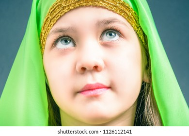Look up a beautiful girl in a green hijab for oriental dance Nubia.