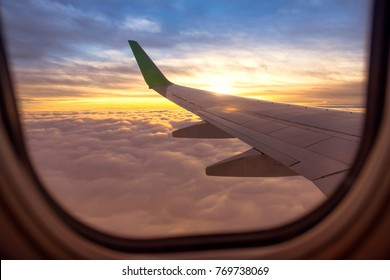 look beautiful sky and Airplane wing on Airplane beside windows with sunrise light