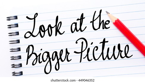 Look At The Bigger Picture written on notebook page with red pencil on the right