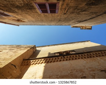 Look up at the blue sky surrounded by the old walls of Mdina Town, Malta