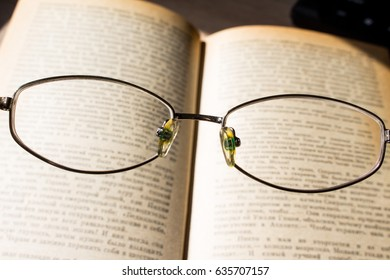 Look at the book through glasses background