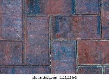 A look close up of a garden brick pattern.