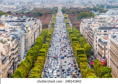 A look down the famous Avenue des Champs Elysees in Paris France as seen from the Arc de Triomphe.