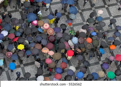 look down on crowd with umbrellas