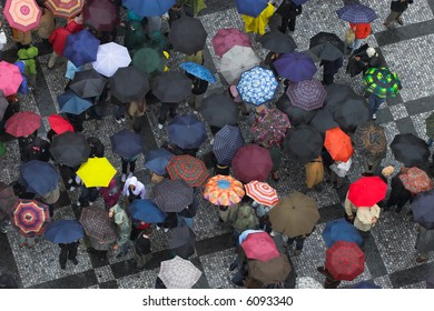 look down on crowd with umbrellas, Praha