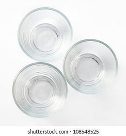 Look down on three empty glasses on a white background