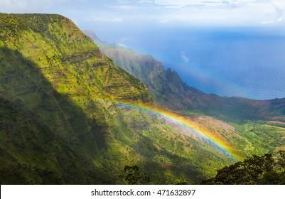 Look down from Pihea trail into Kalalau valley with double rainbow, Kauai, Hawaii. Shoot through a polarizer filter.
