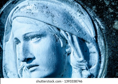 The look and eyes of Virgin Mary. Fragment of ancient statue. Religion, faith, Christianity concept.