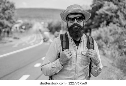 Look for fellow travelers. Tips of experienced backpacker. Man bearded hipster backpacker at edge of highway. Pick me up. Backpacker waiting for car take him anyway just to drop at better spot.