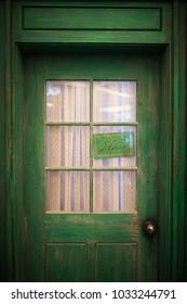 look at the green door.