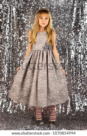 757e90f8b61f Look, hairdresser, makeup. Child girl in stylish glamour dress, elegance.  Fashion model on silver background, beauty. Fashion and beauty, little  princess.
