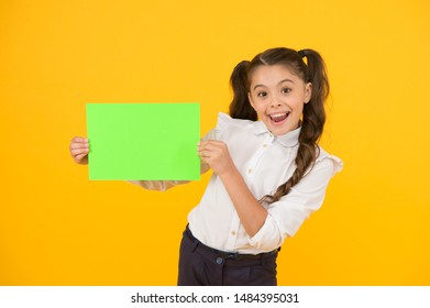 Look here. Girl school uniform hold poster. Back to school concept. Schoolgirl pupil show poster. Schoolgirl hold poster copy space. News information promotion. Changes coming. Upcoming event.