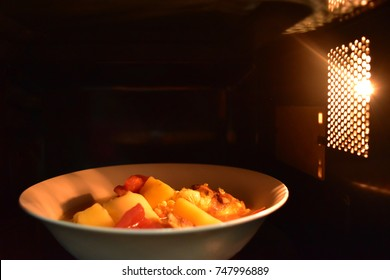 Look inside the microwave food white bowl, In a warm atmosphere and empty top space for text. - Non color ceramic applicable to available with microwave.