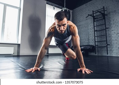 Look inside you. The athlete trains hard his lower and upper body in the gym, doing exercises for calves and glutes. Push-up and press-up, work out. Fitness, healthy life and self-control concept.