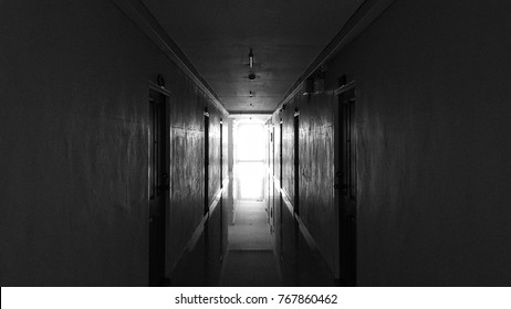 look at The light from the window of an old hotel corridor.