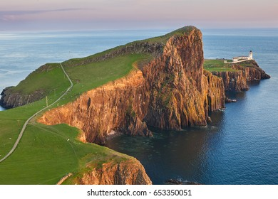 A look at Lighthouse on the cliffs of Neist Point, rugged and rocky coast on the western side Isle of Skye. Famous landmark near Glendale, Skye island, Scotland, United Kingdom, UK, Europe