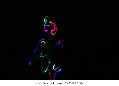 It look like cat playing study lights in motion neon and laser