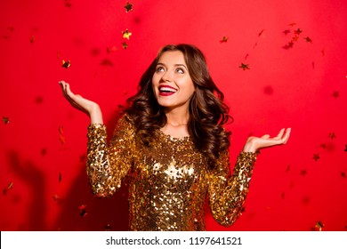 Look like fall stars from the sky! Lady with big white beaming smile look aside stand with modern wave hairdro isolated on vivid red background win winner