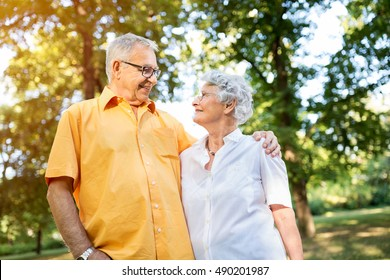 Look of love and satisfaction, senior couple at park