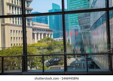Look at the modern office buildings background through the windows in Shanghai