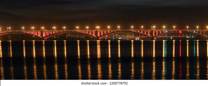 Look on the bridge through the Yenisei River in Siberia, Russia, shooting at night, noise, soft focus