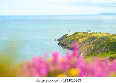 A look on famous landmark lighthouse and Dublin bay on a cloudy sunny day from Howth Head Summit.