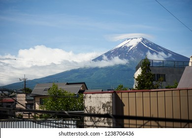 look on fujiyama from a window in fujiyoshida with clear blue sky and a small cloud