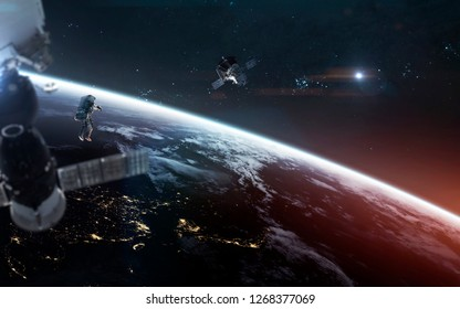 Look on our planet from orbit and astronauts at the spacewalk. Elements of this image furnished by NASA