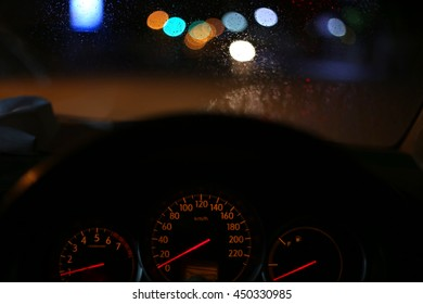 Look on wet city through windshield from inside the car at rain weather  , Drop water on the glass car.