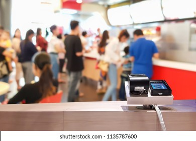 Look out of the counter, blur image of fast food as background.