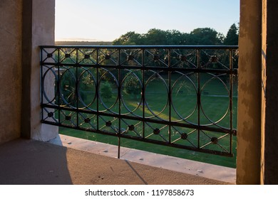 Look out of a french window into a park by low  solar altitude