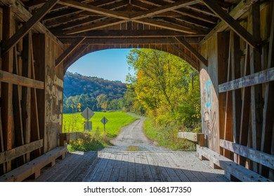 Look out from inside a covered bridge